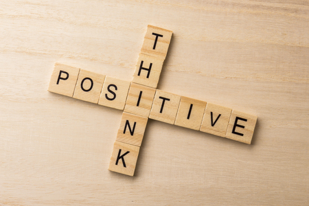 positive thinking - word phrase by letters block wood crossword on wooden background Banco de Imagens