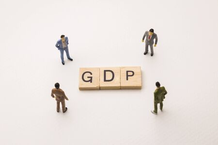 Miniature figures businessman : meeting on gdp letters by wooden block word on white paper background, in concept of business and corporation