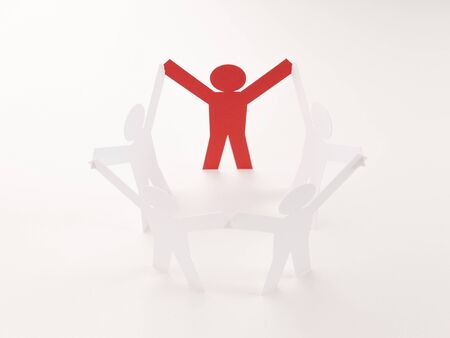 closed joining of five paper figure with red one in hand up posture on bright white background. in concept of business and leadership. selective focused point