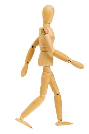 wooden figure in walking step action isolated on white background, Include clipping path.