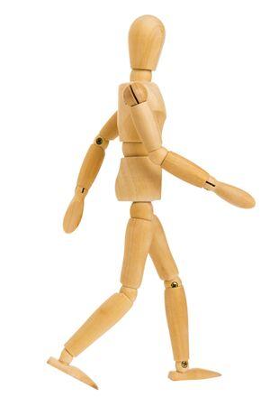 houten figuur in lopende stap actie geïsoleerd op een witte achtergrond, omvat uitknippad. Stockfoto