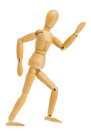 wooden figure in running action isolated on white background, Include clipping path.