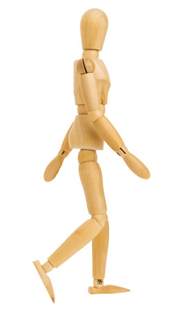 wooden figure in step of walking action isolated on white background, Include clipping path.