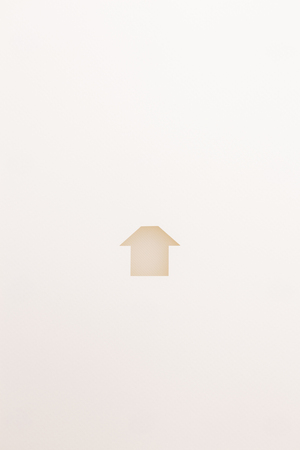 paper cutout in simple house shape by white textured plate on white paper background, for home and insurance conceptual.