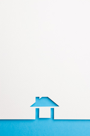white paper cutout in easy house shape with border background by blue paper, for home and insurance conceptual.