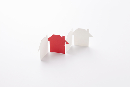 group linked of paper cutout houses with red one on white background, for home and banking conceptual, selective focused.