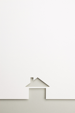 white paper cutout in basic house shape with border background by gray paper, for home and insurance conceptual.
