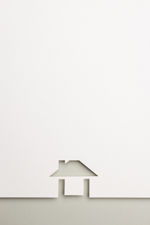 white paper cutout in easy house shape with border background by gray paper, for home and insurance conceptual.