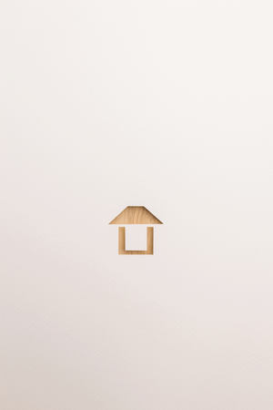 paper cutout in easy house shape by brown wooden textured on white paper background, for home and insurance conceptual.