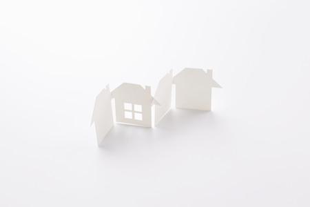 group linked of paper cutout houses with detail one on white background, for home and banking conceptual, selective focused. Banco de Imagens