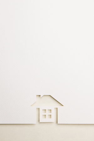 white paper cutout in complete house shape with border background by eyecare paper, for home and insurance conceptual.