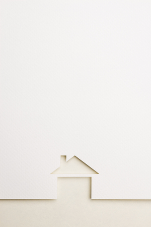 white paper cutout in basic house shape with border background by eyecare paper, for home and insurance conceptual. Stock Photo