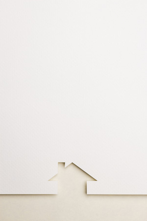 white paper cutout in simple house shape with border background by eyecare paper, for home and insurance conceptual.