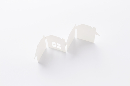 top view of group linked of paper cutout houses with detail one on white background, for home and banking conceptual, selective focused.