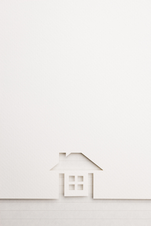 white paper cutout in complete house shape with border background by notepaper, for home and insurance conceptual.