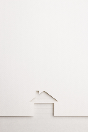 white paper cutout in basic house shape with border background by notepaper, for home and insurance conceptual. Banco de Imagens
