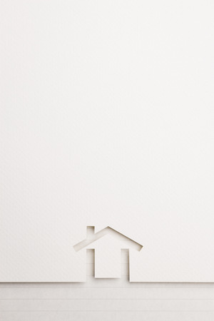 white paper cutout in minimal house shape with border background by notepaper, for home and insurance conceptual.