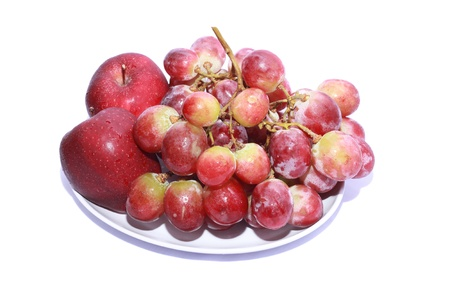 shoot of a bunch of apples and grapes isolated on a white background photo