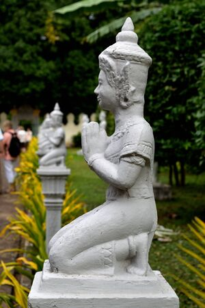 Closeup of a statue in the gardens of the Royal Palace complex of Phnom Penh, Cambodia