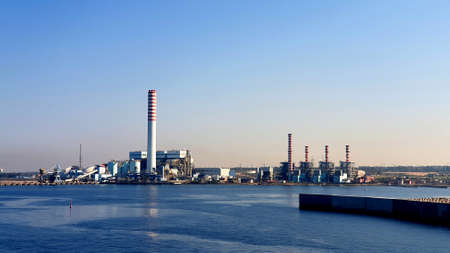 View of a large industry and its industrial smokestacks. Perfect for any use.
