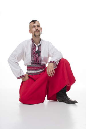 One Cossack in white background. Isolated Stock Photo