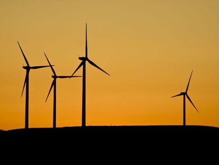 wind turbines at sunset photo