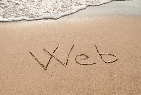 Web written in the sand beach. photo