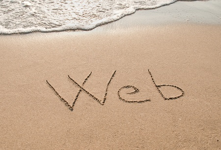 tecnology: Web written in the sand beach.