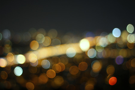 dark city: Beautiful background on dark, out of Focus Lights during the Night Stock Photo