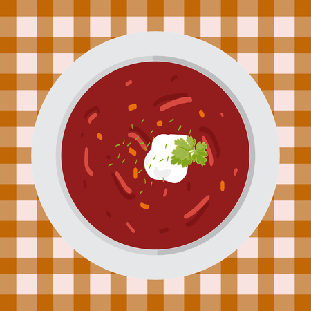Soup borsch with parsley and sour cream on the plate on the table with a tablecloth