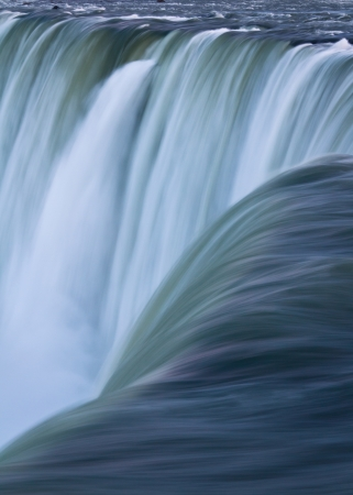 Water over Niagara Falls, Portrait Stock Photo