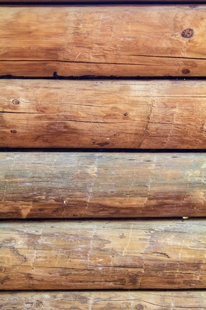 Close up of five logs that are part of a traditional log cabin wall, all in parallel photo