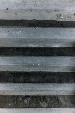 Close up of a row of grey concrete stairs, making an urban grunge background pattern