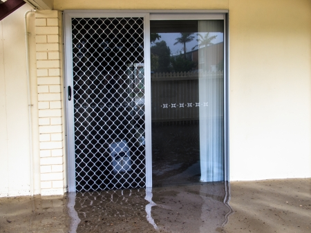 water's: Flood waters running through a screen door