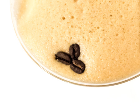 Coffee Martini close up with three coffee beans in the foam photo