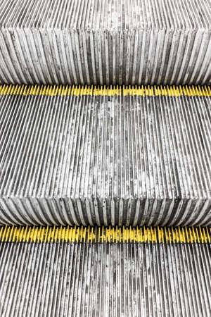 Escalator steps making a modern grunge background