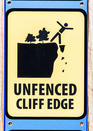 steep cliffs sign: Sign warning of an unfenced cliff edge