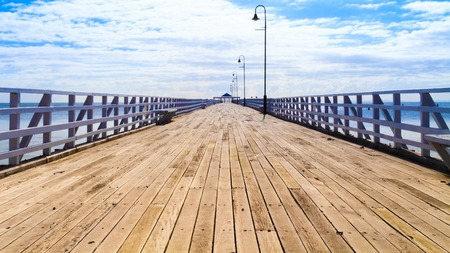 The historic Sandgate Pier lit up by the warm summer sunshine Stock Photo