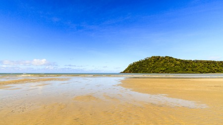 tribulation: The beautiful yellow beach and blue sea at Cape Tribulation in the Daintree rainforest, in Queensland, Australia