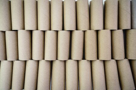 Wall made of brown cardboard toilet rolls