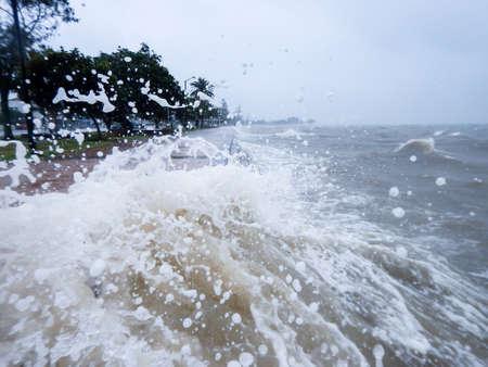 Ocean splash over the sea wall at Sandgate Brisbane.