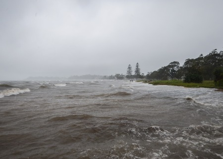 the surge: Storm surge tide at Sandgate in Brisbane after Cyclone Marcia. Stock Photo