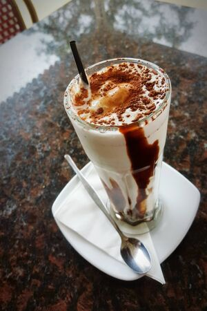 A traditional Australian ice chocolate in a tall glass