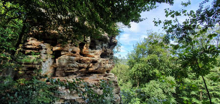 Irrel Germany July 2020 rock formation with gorge in the forest in beautiful weather with blue sky