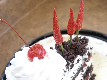 Cake with chilies as candles