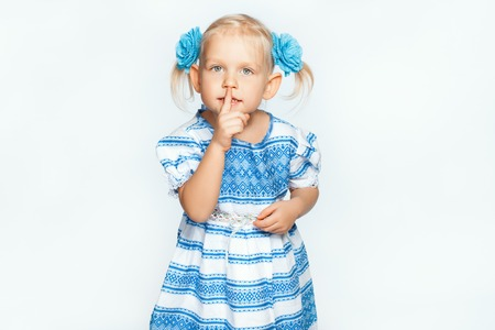 shh: Beautiful baby girl on a white background making shh Stock Photo