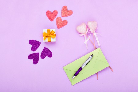 Gift and letter to Valentines Day on a pink background Stock Photo