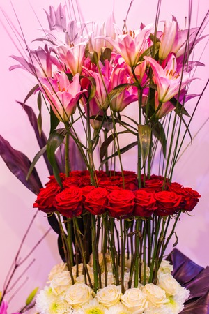 Beautiful multi-tier bouquet of lilies and roses.
