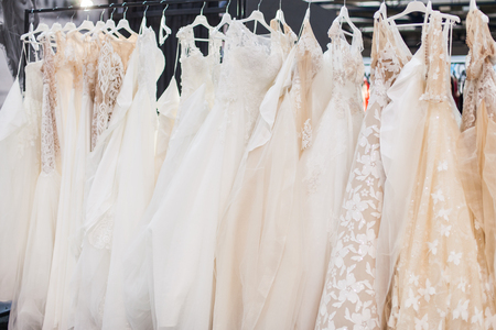 Stand with many gorgeous wedding dresses in the showroom. Imagens