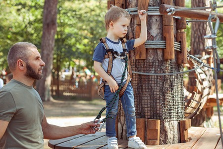 Young dad with his son in extreme park. Imagens
